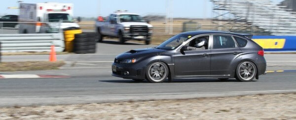 Into Turn 1 on Thunderbolt at NJMP with my Subaru STi