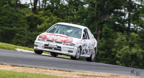 Cars - Subaru 2.5 RS race car with 3 wheels in the air